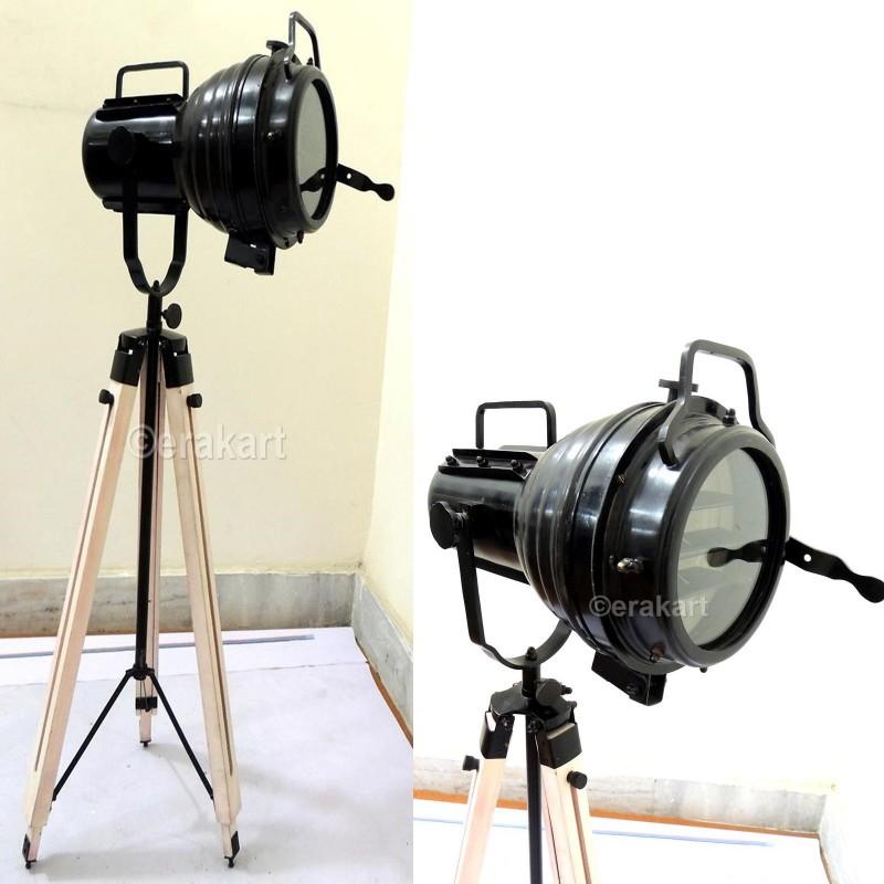 vintage industrial spotlight on wooden tripod